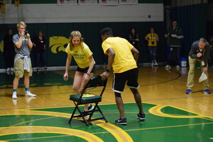 Seniors Olivia Hellweg and Blake Jones battle to win musical chairs in the final round.