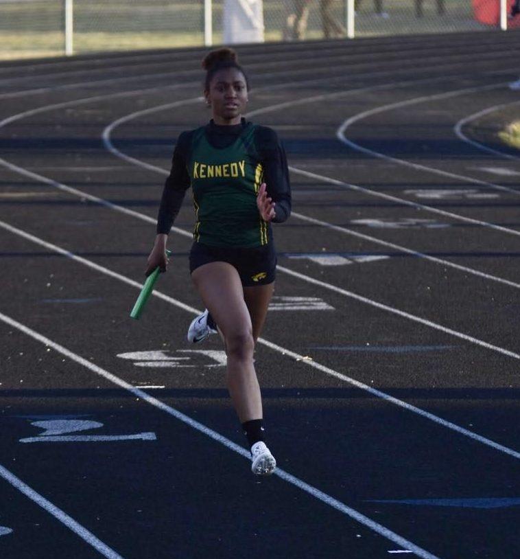Jurnee Rose-Johnson, sr., running in the third leg of the  4x200.