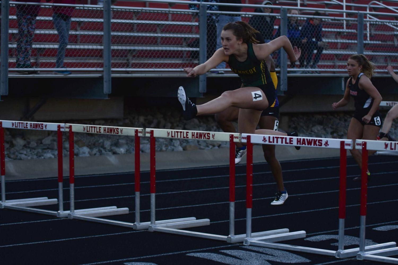 Natalie McAllister sr., running the fourth leg of the shuttle hurdle.