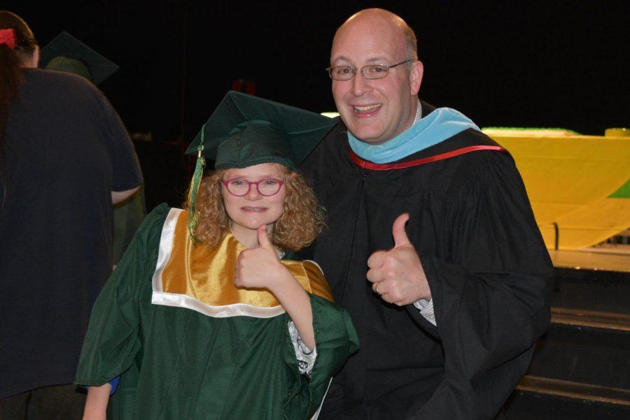 Principal Jason Kline and Ellie Grovert sr., giving a big thumbs up for graduation.
