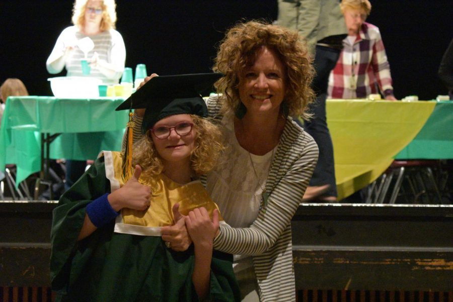 Ellie Grovert sr., and Stephanie Grovert posing for a mommy daughter photo on such a special day.