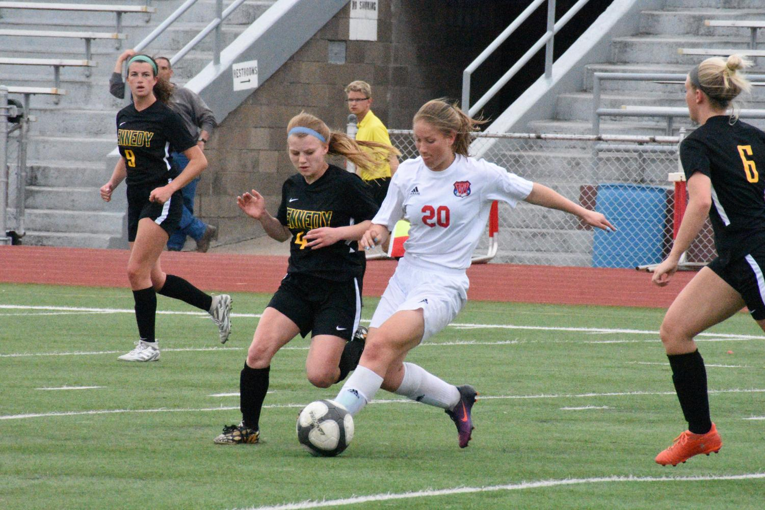 Hannah Mundell, sr., trying to steal the ball from Washington, to pass to Dekko.