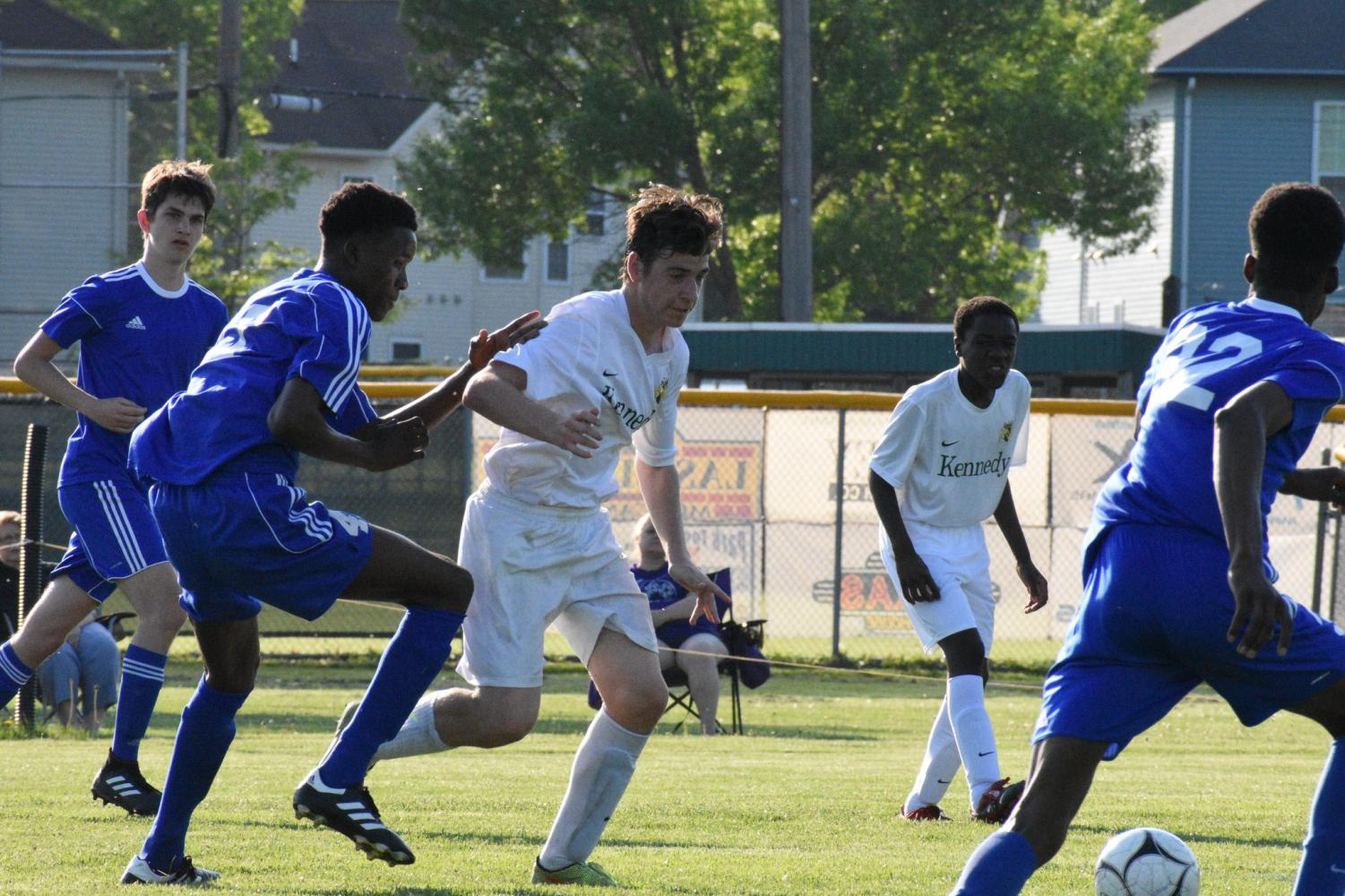 Conrado Chozas-Martinez racing towards the ball, against Washington Warriors. The JV 2 soccer game was on May 16, losing 3-2.