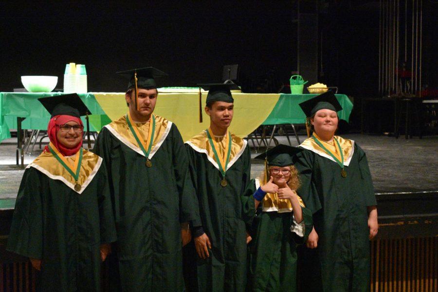 Seniors Sarah Alterbal, Dekota Berry, Nic Luongvan, Ellie Grovert, Hannah Jacoby all ready for graduation.
