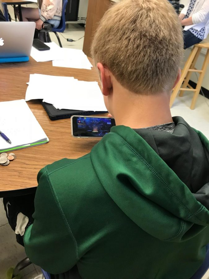 Senior Jackson Foley plays Fortnite before his first period class. Fortnite has risen to great popularity at Kennedy and is played by a wide variety of students.