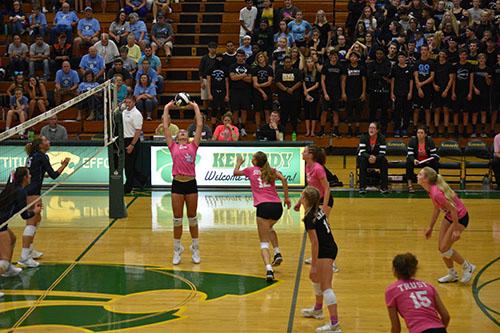 Abby Feldmann, jr., sets the ball to the right side.