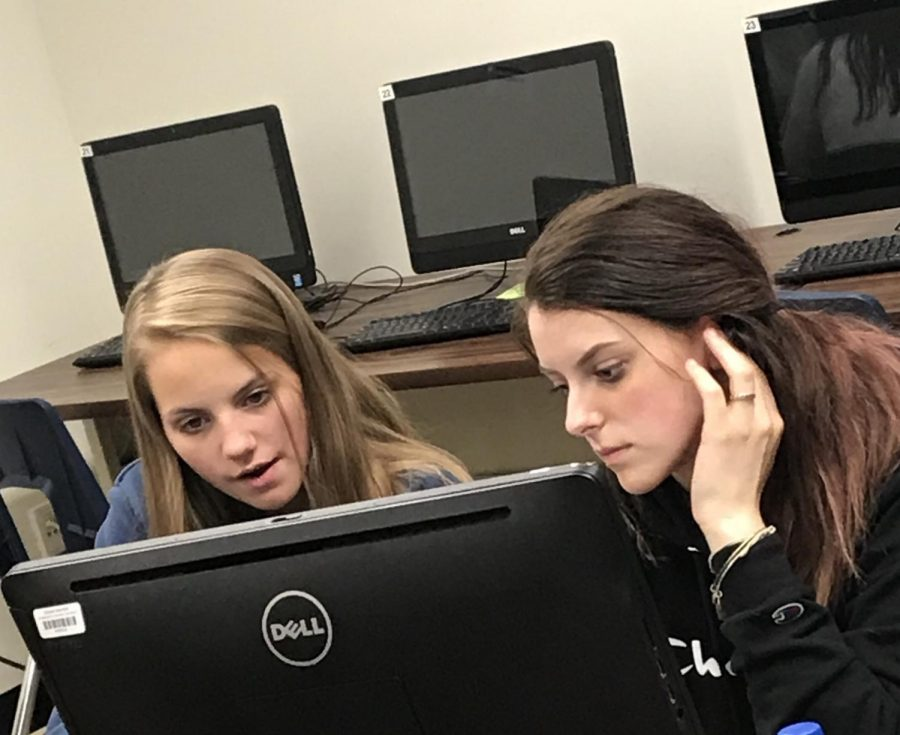 Jordyn Cory and Elizabeth Frost using technology in the classroom.