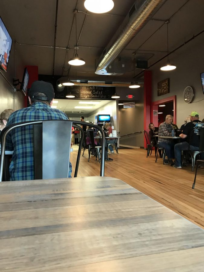 The interior of Urban Pie is new and sleek. There is plenty of seating and a few TVs available to costumers.