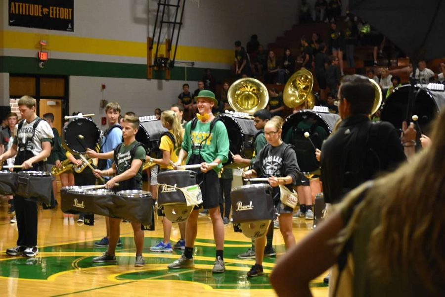 Band students help hype up the students at the fall pep assembly.