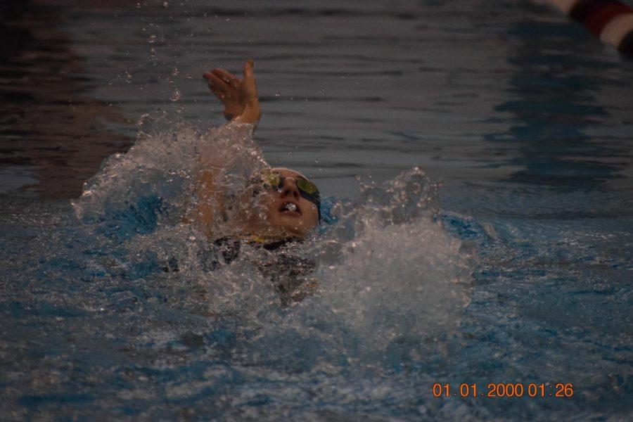 Senior Sydney Harris, backstroke.