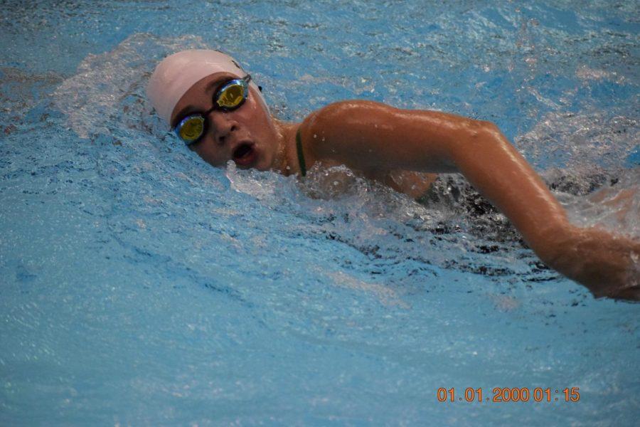 Freshman Bethany Smeed swimming freestyle.