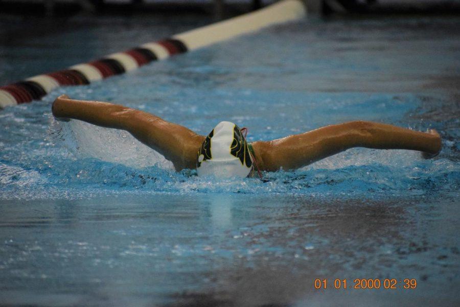Freshman Emma Dworzynski swimming fly.