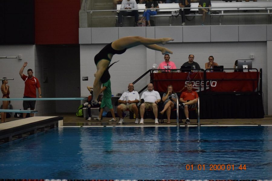 Junior Ellie Pins, diving into action.