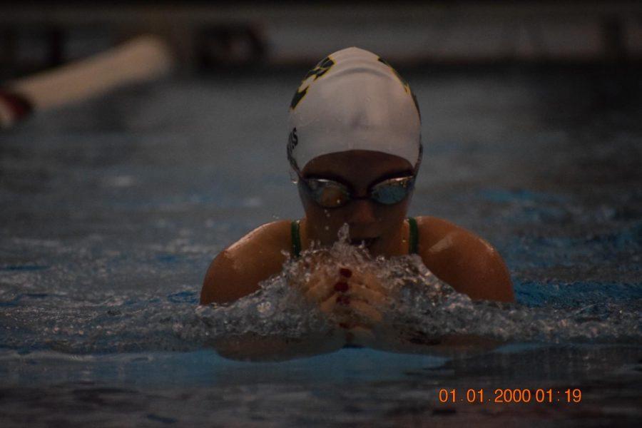 Sophomore Kacey Davis swimming breast stroke.