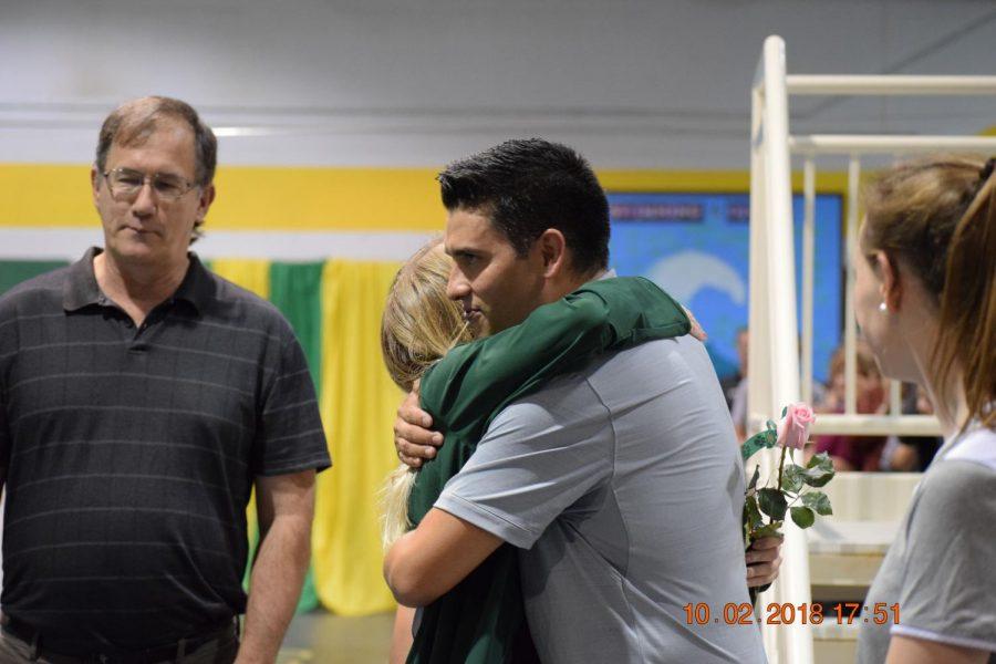 Cassie+Hansen+gets+a+big+hug+from+coach+Ivan+Sanchez.+