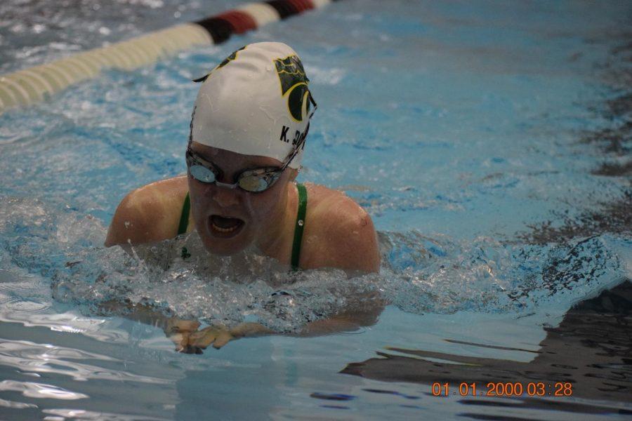 Sophomore Katie Doyle swimming breast stroke.
