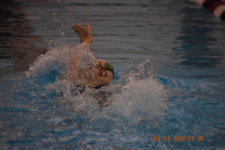 Senior Sydney Harris, swimming backstroke.