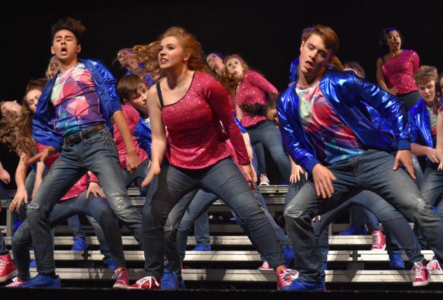 Left to right; Noah Loehr jr., Megan Holtzman sr., and Jacob Kiesey sr., dancing to