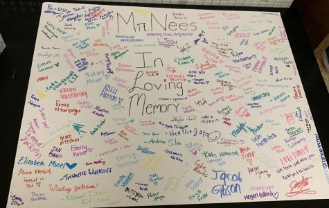 Students signed this poster in the hallways to write their memories or condolences.