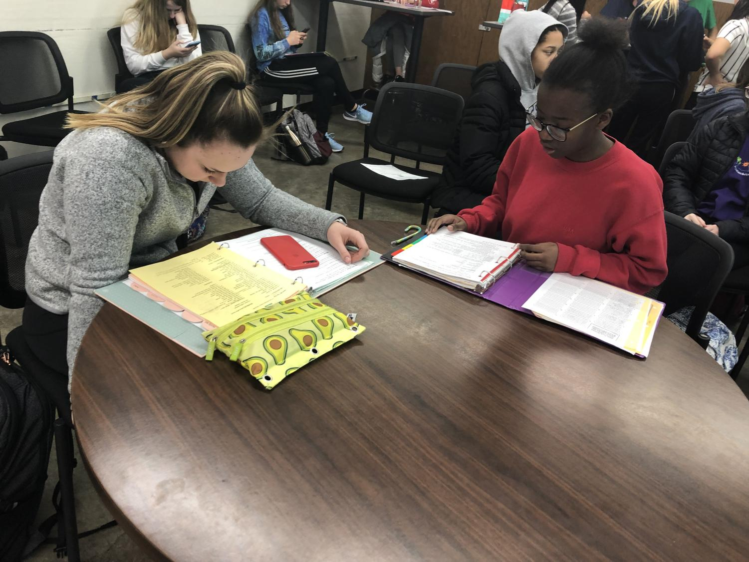 Lydia Heskje, so., and Grace Ntanyungu, fr., studying for their tests and finals in French class.