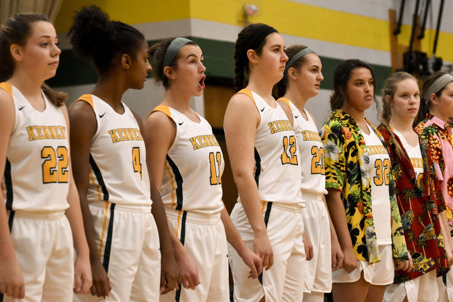 Kennedy's women basketball team line up for the National Anthem.