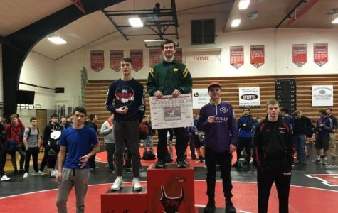 Dylan Falck receiving first place at Fort Madison Invitational on Dec. 15, 2018.