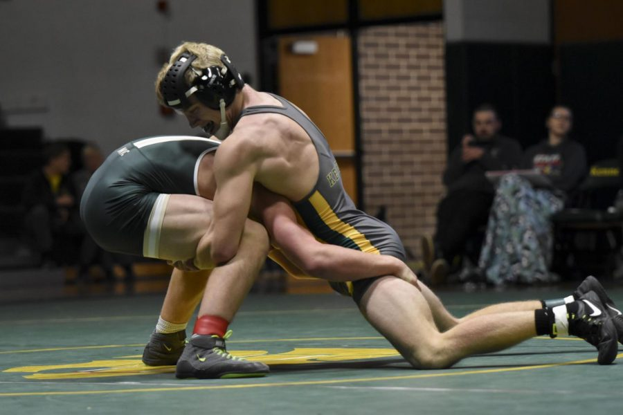 Will Stecker, former Kennedy wrestler, wrestling vs. Dubuque Hempstead.
