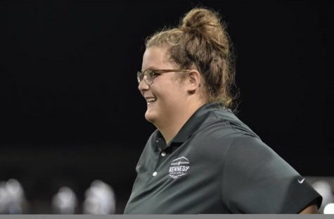 Senior Kamae Jacobus smiles as she looks out at the football field.