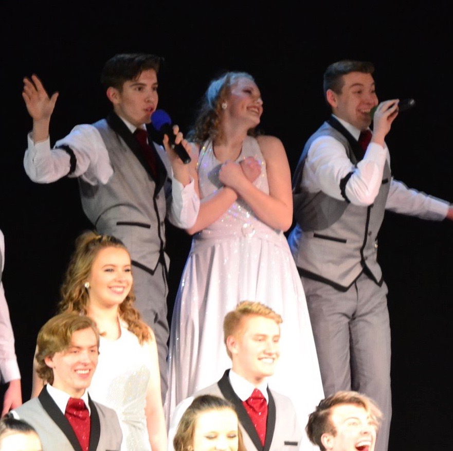 Junior Wolfgang (Amadeus) Borchardt, junior Betsy Marlow and senior Brayden Remerowski sing at the Going Out Concert on Thursday, March 7. Remerowski and Borchardt usually switch off singing the solo, but this time they sang together.
