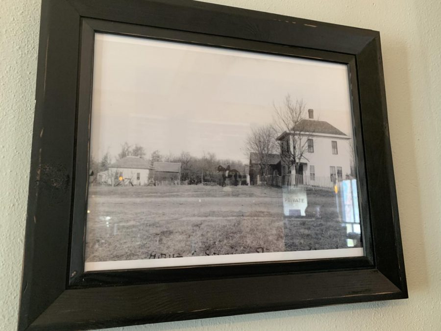 Framed photograph of the original house that Dry Creek is located in.