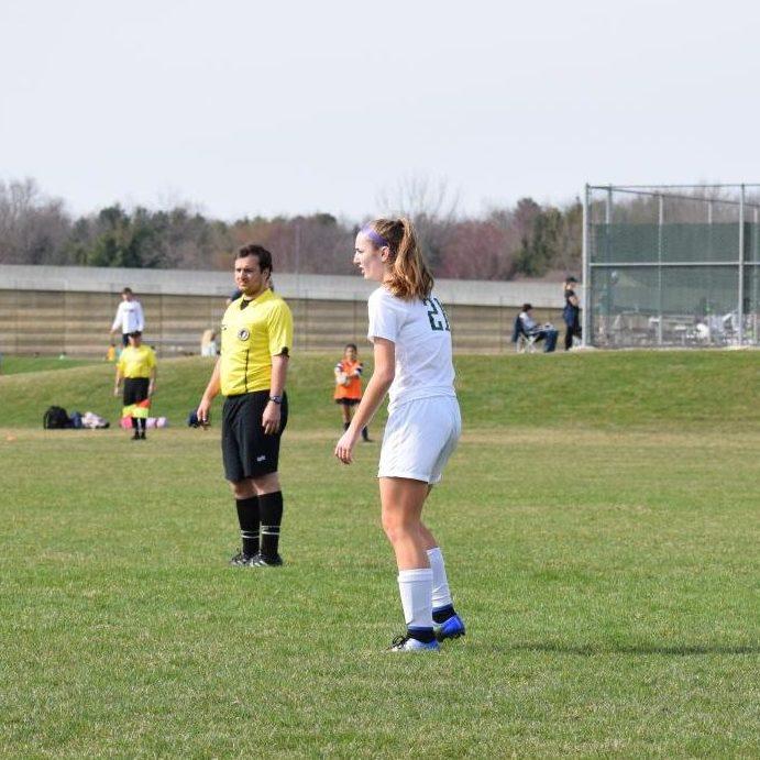 Junior+Abby+Feldmann+gets+ready+to+pass+the+ball.