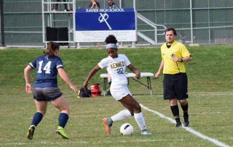 Junior Camryn Ray handles the ball during the team's game against Xavier on April 16.