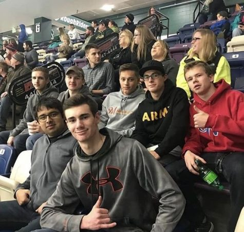Peterson (bottom front) and other future soldiers at the Rough Riders Ice Arena attending an event for Veterans Day, 2018