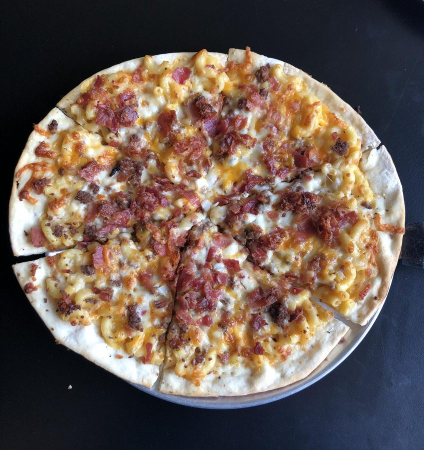 Mac and Cheese pizza with bacon and ground beef.