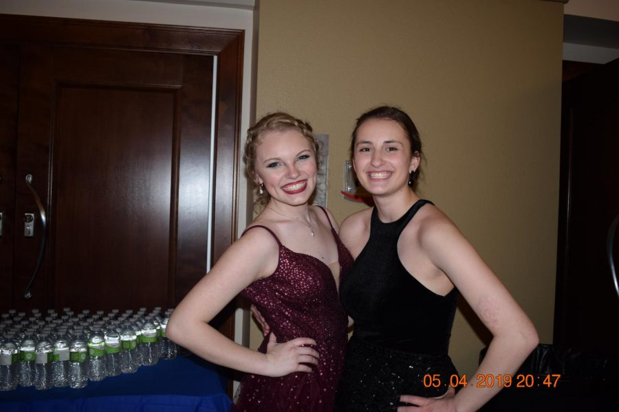 Junior Betsy Marlow and senior Delaney Golden outside of the ballroom at the Czech Museum.