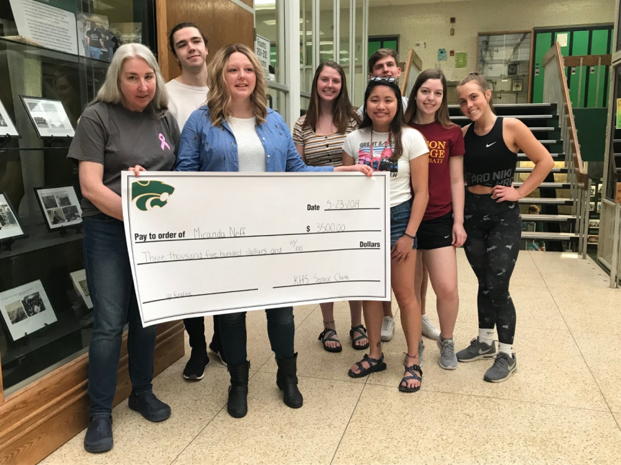 Students Olivia Schirm, Michael Gallagher, Brenna Hartse, Mackenzie Pattridge, and Gwyneth Smith hand over the rest of their class funds to Miranda Neff (center) who is battling breast cancer.