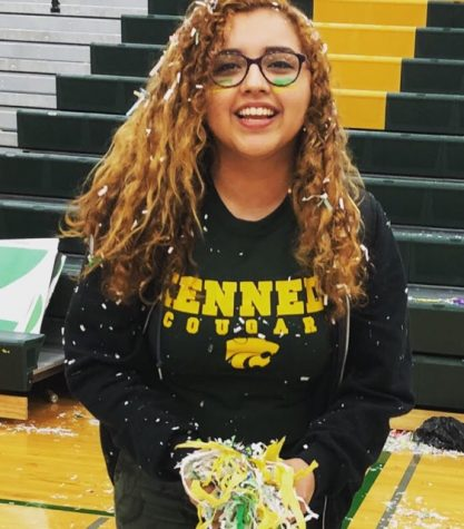 Jackie Garcia attending a pep assembly at Kennedy High School, posing with handfuls of confetti.