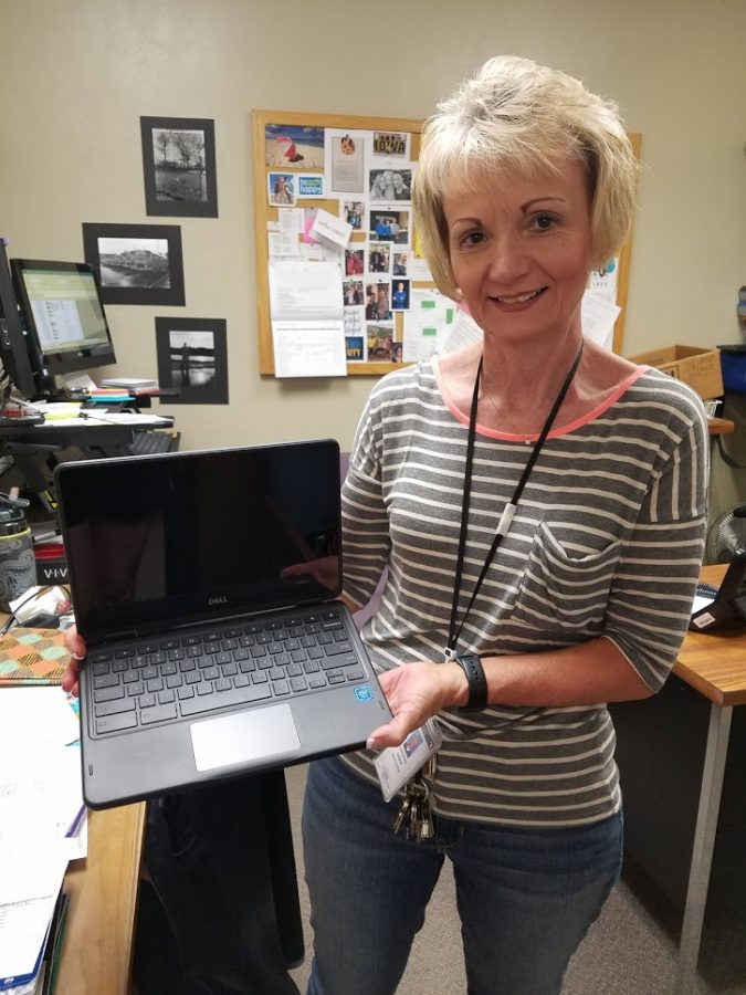 Deborah Baber, the Kennedy High School technology facilitator, with the Dell Chromebook students will be receiving next year.