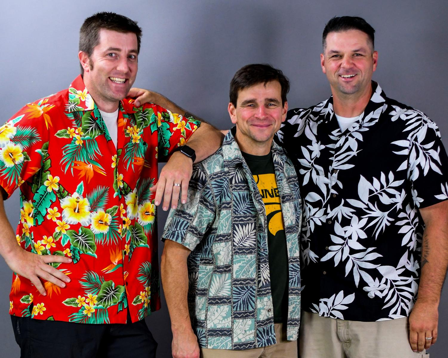 Steven Tolly, Dan Carolin, and George Anderson all wearing their Hawaiian shirts in memory of their friend.