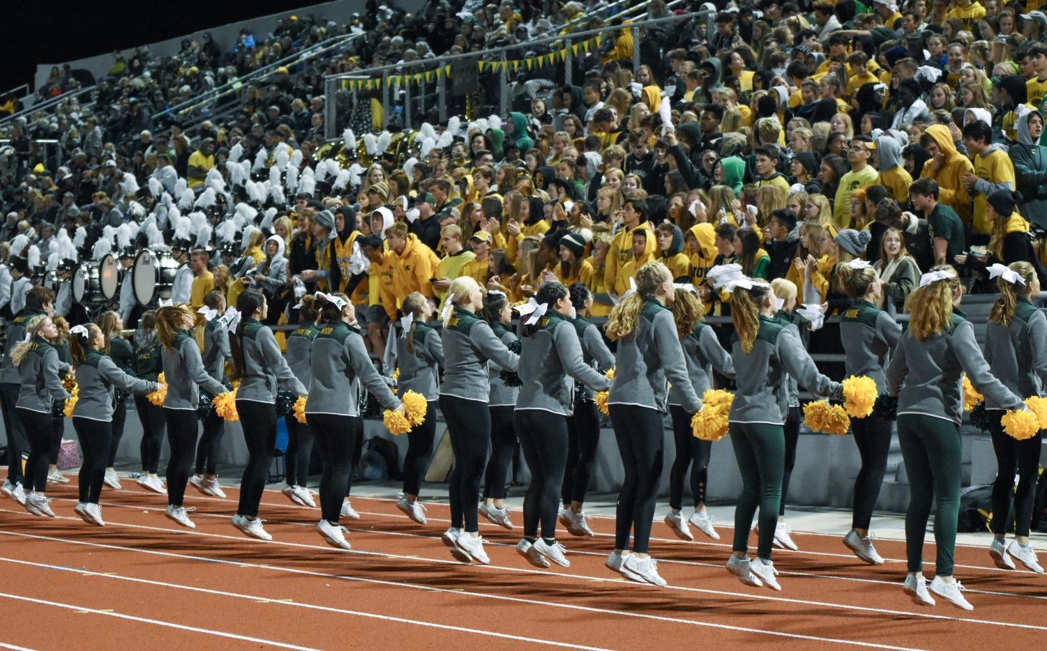 Kennedy student section focused on the game while the cheerleaders perform.