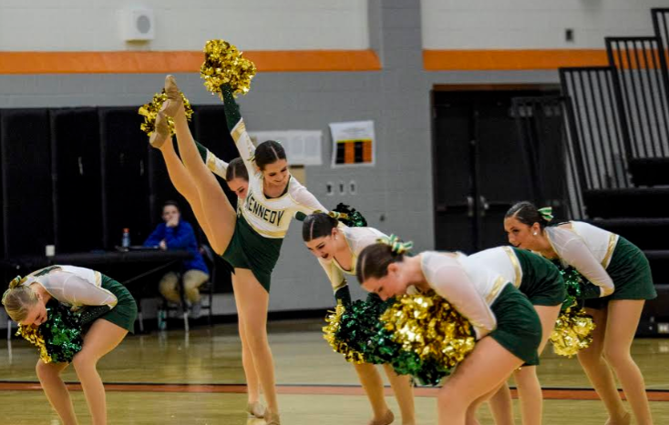 The Kennedy Varsity Dance Team performing their pom routine at Prairie's Stack the Stands.