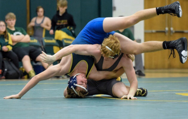 Kennedy wrestler, moments from pinning his opponent.
