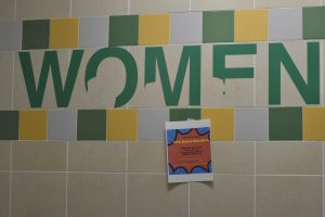 The women's bathroom stall near the gym, prior to being painted.