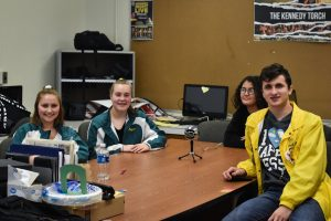 Noah Hargrafen, Hannah Retz, Morgan Mahoney and Jasmine Hite sit about the recording table.