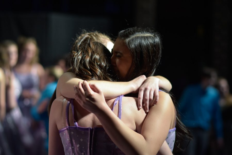 Happiness+members+come+together+for+a+tear-filled+hug+after+their+final+performance+for+the+season.