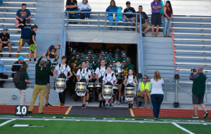 The Kennedy marching band entering before a football game last season.