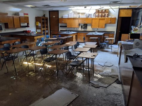 Derecho winds caused the roof to fall in around the school.