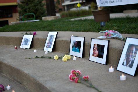 Photos of victims of police brutality were placed on the stairs during the vigil. Attendees of the vigil laid flowers, candles and other memorabilia by the photos.