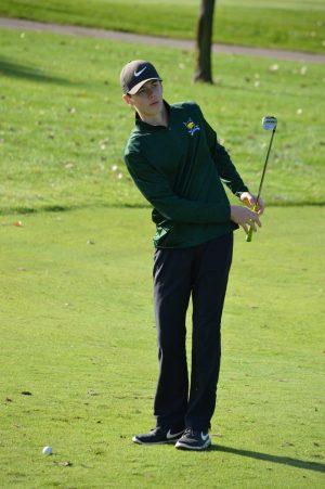 Simeon Jauhiainen, jr., takes a chip-shot at the Boys JV golf meet at Hunter's Ridge Golf Course on Sept. 29
