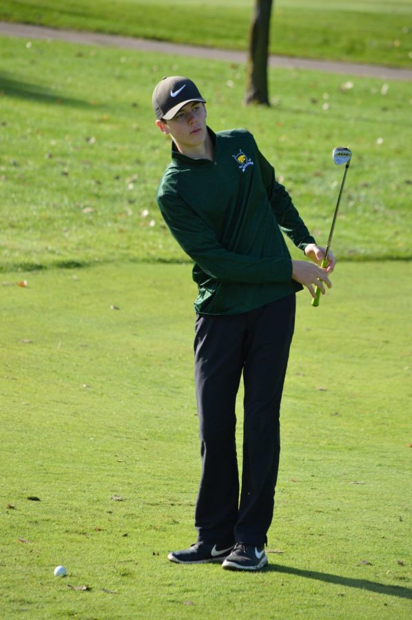 Simeon Jauhiainen, jr., takes a chip-shot at the Boys JV golf meet at Hunter's Ridge Golf Course on Sept. 29